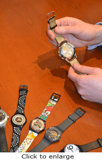 Fashion-oriented Swatch watches with quartz technology compared with a mechanical watch.