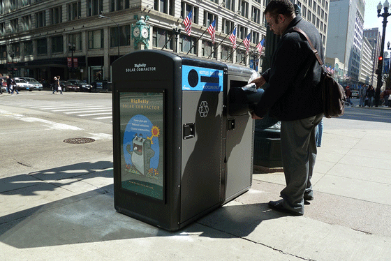 A Chicago citizen enjoys the benefits of a Bigbelly trash compactor.