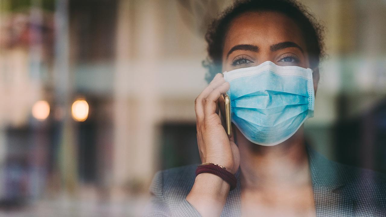 Woman wearing mask.